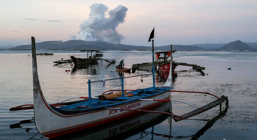 fisherman Taal Volcano Batangas 012020 - Taal alert level lowered further