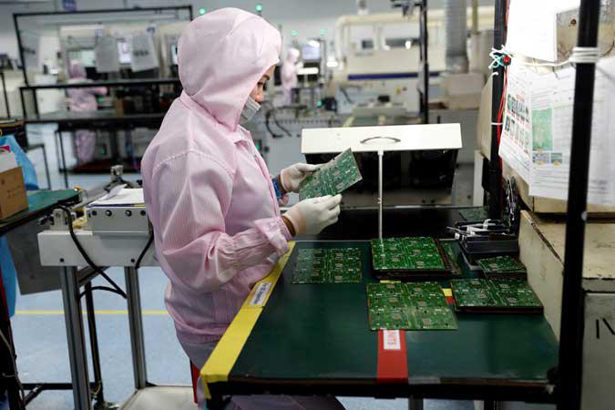 Euro zone factory downturn eased in February despite virus fears - PMI