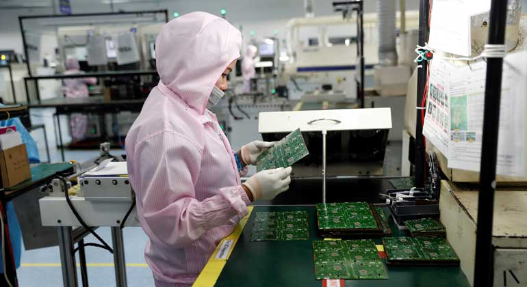 electronics factory manufacturing - Factory output declines for third straight month