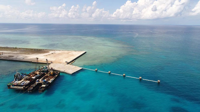 2020 06 10T035632Z 1353078781 RC236H9U9YUD RTRMADP 3 PHILIPPINES SOUTHCHINASEA - Philippines says won't stop projects with China firms blacklisted by US