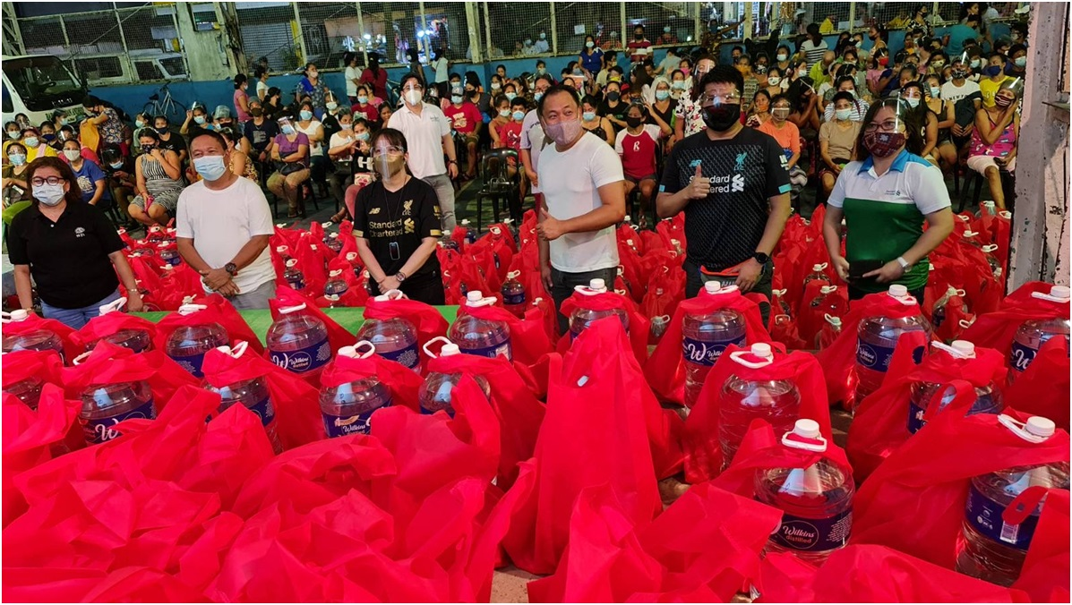 2 1 - Standard Chartered Bank distributes relief support to flood victims